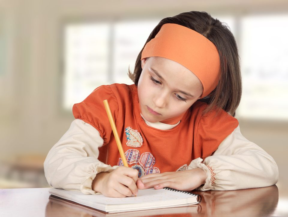 Adorable girl doing her homework